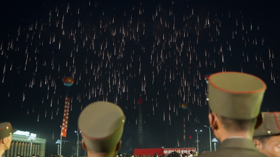 Soldiers of the Korean People's Army (KPA) watch a fireworks displayin Pyongyang on July 6, 2017, as part of celebrations marking the July 4 launch of the Hwasong-14.