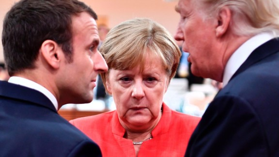(L-R) French President Emmanuel Macron, German Chancellor Angela Merkel and US President Donald Trump confer at the start of the first working session of the G20 meeting in Hamburg, northern Germany, on July 7. Leaders of the world