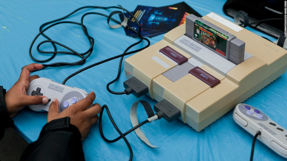 "The Super Nintendo Entertainment System, or SNES, was released to US consumers in 1991, and became the best-selling gaming console of its generation. With its advanced graphics and classic games like ""Donkey Kong Country,"" ""Super Mario World"" and ""The Legend of Zelda: A Link to the Past,"" Nintendo sold more than 49 million of the systems worldwide."