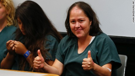 Isabel Martinez gives a thumbs-up to cameras as she appears in court  Friday in Lawrenceville, Georgia.