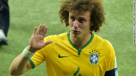 David Luiz leaves the field in tears. The defender was heavily criticized for his role in the defeat.
