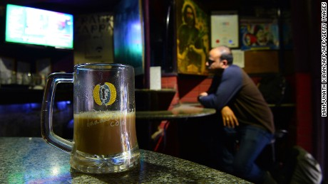 Drinkers are served coffee in a beer mug at Pecos, one of Bengaluru's oldest pubs.