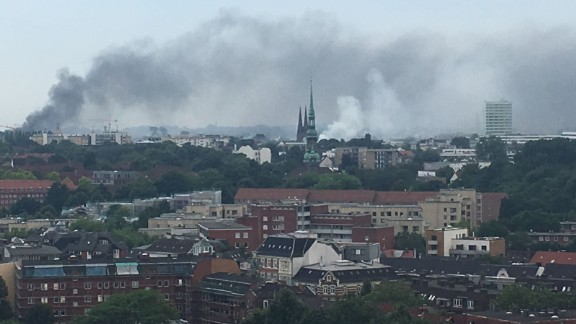 Police say protesters have set vehicles and other objects on fire in Hamburg.