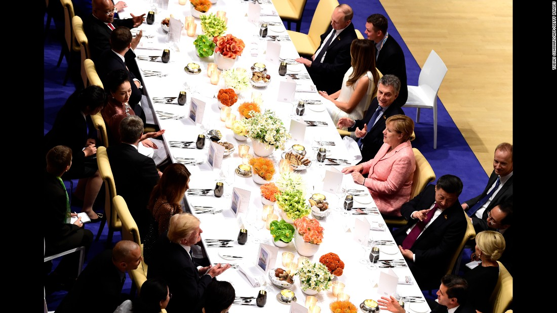 Germany's Merkel, center, right, hosts the banquet. At top right, Russian President Vladimir Putin sits next to US first lady Melania Trump. Donald Trump, bottom, left, across from Chinese President Xi Jinping.
