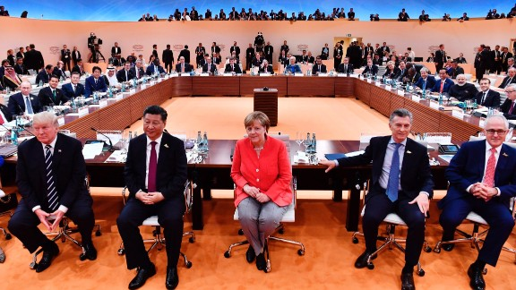 TOPSHOT - (L-R) US President Donald Trump, China's President Xi Jinping, German Chancellor Angela Merkel, Argentina's President Mauricio Macri and Australia's Prime Minister Malcolm Turnbull at the start of the firstG20  working session of the G20 meeting in Hamburg last week.