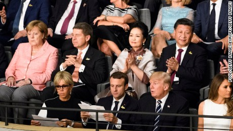 HAMBURG, GERMANY - JULY 07:  German Chancellor Angela Merkel, Joachim Sauer, US President Donald Trump (2-R), his wife Melania Trump (R), French President Emmanuel Macron (2-L), his wife Brigitte Macron (L), Chinese President Xi Jinping (top R), his wife Peng Liyuan (top C) attend a concert at the Elbphilharmonie philharmonic concert hall on the first day of the G20 economic summit on July 7, 2017 in Hamburg, Germany. The G20 group of nations are meeting July 7-8 and major topics will include climate change and migration. .  (Photo by Michael Ukas - Pool / Getty Images)