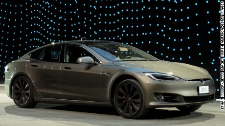A Tesla Model S P100D in Ludicrous Mode is shown during a speed test against Faraday Future's FF 91 prototype electric crossover vehicle (not shown) during the FF 91's unveiling at a press event for CES 2017 at The Pavilions at Las Vegas Market on January 3, 2017 in Las Vegas, Nevada.