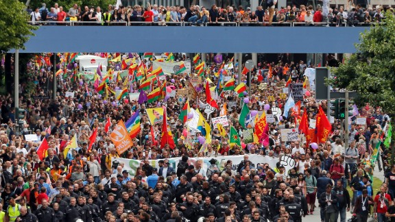 Police escort a protest rally at the G20 summit in Hamburg on Saturday.