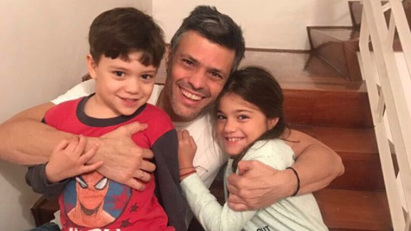 Leopoldo Lopez joins his children at home in a photo released by his family.