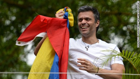 "Venezuelan opposition leader Leopoldo Lopez displaying a Venezuelan national flag, greets supporters gathering outside his house in Caracas, after he was released from prison and placed under house arrest for health reasons, on July 8, 2017. Venezuela's Supreme Court confirmed on its Twitter account it had ordered Lopez to be moved to house arrest, calling it a ""humanitarian measure"" granted on July 7 by the court's president Maikel Moreno. ""Leopoldo Lopez is at his home in Caracas with (wife) Lilian and his children,"" Lopez's Spanish lawyer Javier Cremades said in Madrid. ""He is not yet free but under house arrest. He was released at dawn."" / AFP PHOTO / Federico PARRA        (Photo credit should read FEDERICO PARRA/AFP/Getty Images)"