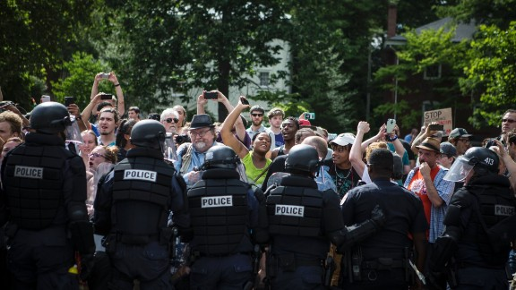 CHARLOTTESVILLE, VA - JULY 08: Counter protestors are held back by riot police as the Ku Klux Klan leaves a staged rally on July 8, 2017 in Charlottesville, Virginia.  The KKK is protesting the planned removal of a statue of General Robert E. Lee, and calling for the protection of Southern Confederate monuments. (Photo by Chet Strange/Getty Images)