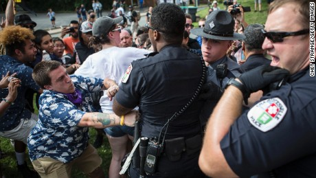 Officers clash with counter protestors who turned out in reaction to a KKK rally.
