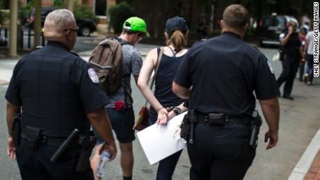 A counter protestor is arrested Saturday in Charlottesville.
