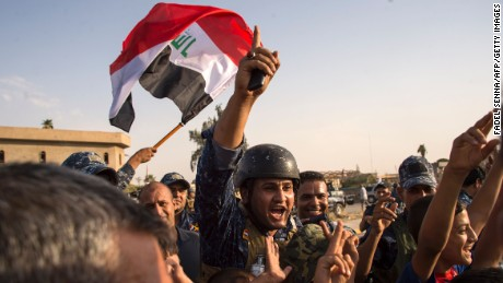 Iraqi forces celebrate the retaking of Mosul on Sunday.