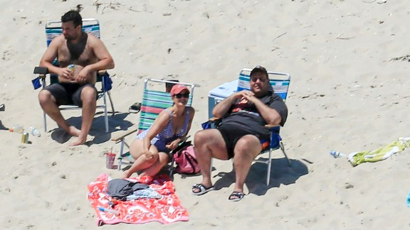 In July, Christie spends time with family and friends at Island Beach State Park, where the governor has a summer residence. They were the only ones there because two days earlier, Christie shut down the state government after the Legislature failed to pass a budget. All state-run tourist attractions were closed to the public.