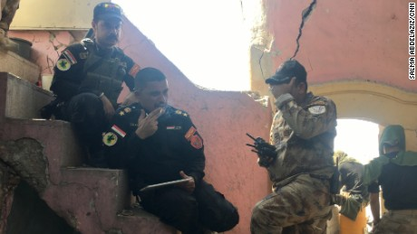 Major Salam Hussein of CTS, center, with a tablet that provides a live surveillance feed.