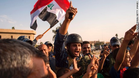 Iraq's federal police celebrate victory in the Old City of Mosul.