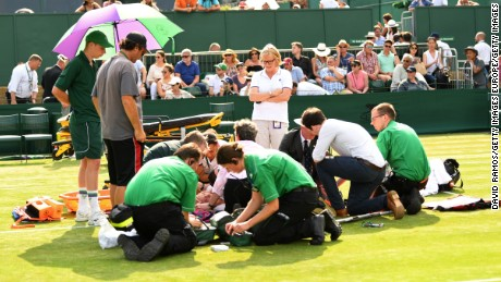 Bethanie Mattek-Sands receives treatment from paramedics following her fall last Thursday.