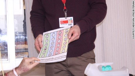 Chaplain Joel Berning uses the spiritual care board in the ICU