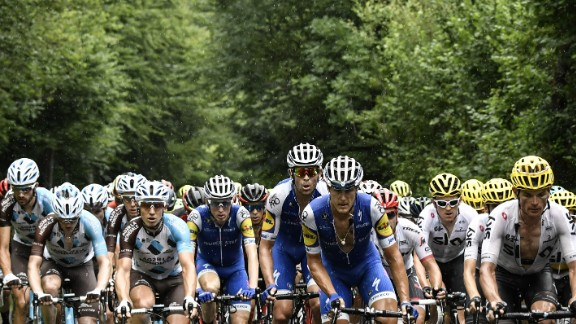 The pack rides in the rain during the ninth stage between Nantua and Chambery.