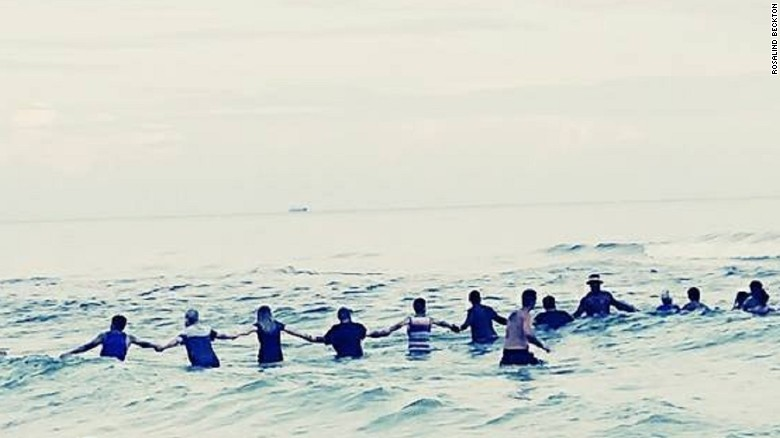 Human chain rescues trapped swimmers