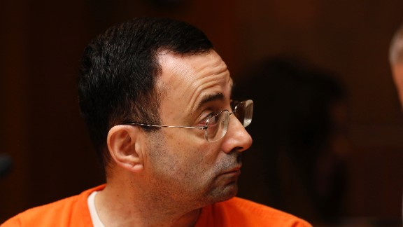 Former Michigan State University and USA Gymnastics doctor Larry Nassar is seen in the 55th District Court where Judge Donald Allen Jr. bound him over on June 23, 2017 in Mason, Michigan to stand trial on 12 counts of first-degree criminal sexual conduct. / AFP PHOTO / JEFF KOWALSKY        (Photo credit should read JEFF KOWALSKY/AFP/Getty Images)