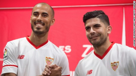 Sevilla FC football team's new players Argentinian midfielder Guido Pizarro (L) and Argentinian midfielder Ever Banega shake hands during their official presentation at the Ramon Sanchez Pizjuan stadium in Sevilla on July 10, 2017. / AFP PHOTO / JORGE GUERRERO        (Photo credit should read JORGE GUERRERO/AFP/Getty Images)