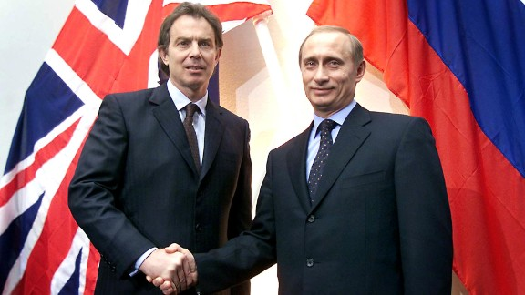 Putin shakes hands with British Prime Minister Tony Blair after a news conference in London in April 2000.