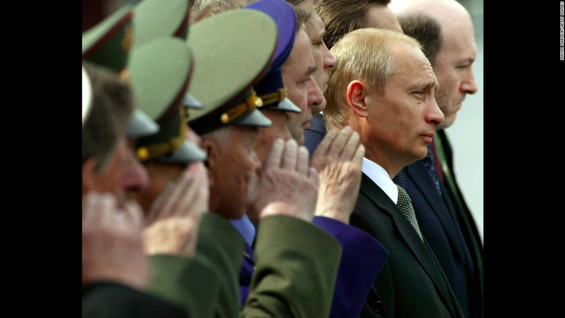 Putin watches honor guards march at the Tomb of the Unknown Soldier during a wreath-laying ceremony in Moscow in June 2003.