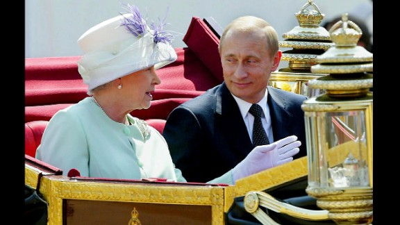 Putin leaves in an open carriage with Britain's Queen Elizabeth II during a ceremonial welcome in London in June 2003.