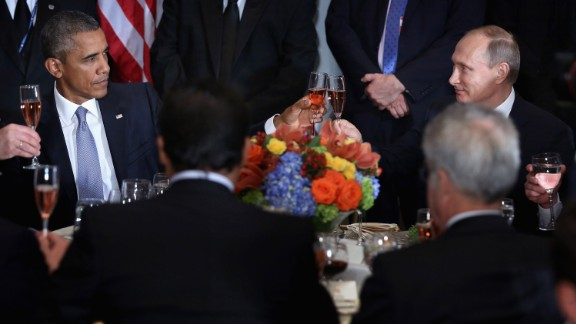 """US President Barack Obama shares a toast with Putin at a luncheon in New York hosted by UN Secretary-General Ban Ki-moon in September 2015. """"Amid the inevitable trials and setbacks, may we never relax in our pursuit of progress and may we never abandon the pursuit of peace,"""" Obama said before clinking glasses. """"Cheers."""" The two, bitterly at odds over issues in Ukraine and Syria, had a closed-door meeting later in the day."""