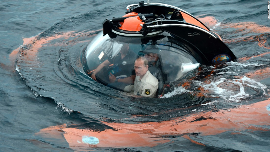 Putin sits in a bathyscape as it plunges into the Black Sea in August 2016. He went underwater to see the wreckage of an ancient merchant ship that was found earlier in the year.