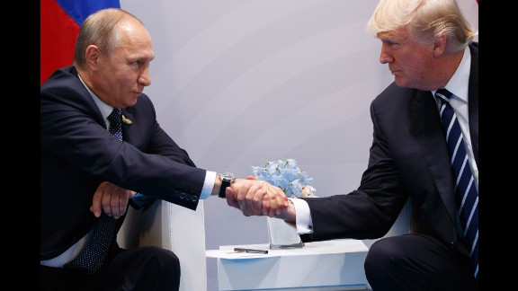 Putin shakes hands with US President Donald Trump as they meet on the sidelines of the G20 summit in Germany in July 2017. They talked for more than two hours, discussing interference in US elections and ending with an agreement on curbing violence in Syria.