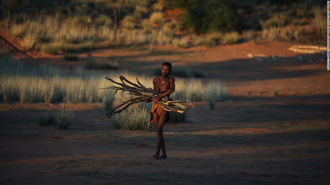 "The landscape is on the border of Kalahari Gemsbok National Park (KPNG). Many of the Khomani San groups were <a href=""http://edition.cnn.com/2011/WORLD/africa/01/20/botswana.bushmen/"">forcibly removed from their ancestral land in 2002 </a>by neighboring Botswana's government to make way for diamond mining, threatened their nomadic way of life."