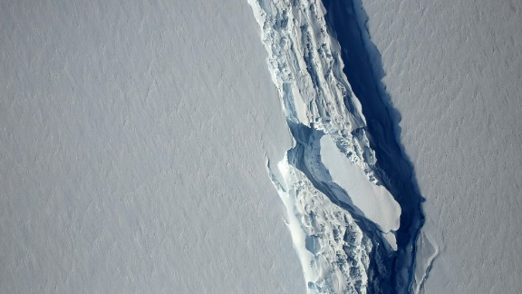 """(FILES) This file photo taken on November 11, 2016 shows an image obtained from NASA showing the Antarctic Peninsula's rift in the Larsen C ice shelf from NASA's IceBridge mission Digital Mapping System.  A trillion-tonne iceberg, one of the biggest on record, has snapped off the West Antarctic ice shelf, said scientists on July 12, 2017, who have monitored the growing crack for months. """"The calving occurred sometime between Monday, July 10 and Wednesday, July 12, when a 5,800-square kilometre (2,200-square mile) section of Larsen C (ice shelf) finally broke away,"""" the Swansea University said in a statement.   / AFP PHOTO / NASA's Goddard Space Flight Center / HO / RESTRICTED TO EDITORIAL USE - MANDATORY CREDIT AFP PHOTO /NASA's Goddard Space Flight Center  - NO MARKETING - NO ADVERTISING CAMPAIGNS - DISTRIBUTED AS A SERVICE TO CLIENTS  HO/AFP/Getty Images"""