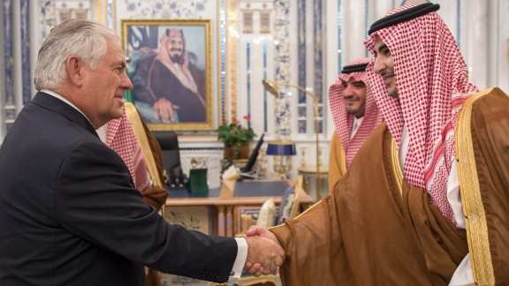 """A handout picture provided by the Saudi Press Agency (SPA) on July 12, 2017, shows US Secretary of State Rex Tillerson (L) greeting Saudi officials ahead of his meeting with the King Salman in Jeddah. / AFP PHOTO / SPA / STRINGER / === RESTRICTED TO EDITORIAL USE - MANDATORY CREDIT """"AFP PHOTO / HO / SPA"""" - NO MARKETING NO ADVERTISING CAMPAIGNS - DISTRIBUTED AS A SERVICE TO CLIENTS ===STRINGER/AFP/Getty Images"""