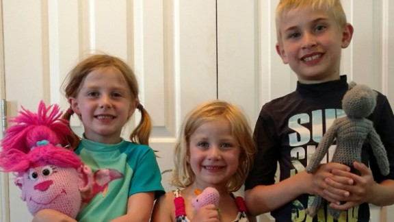 Evelyn Londt (1st grade), Isabella Londt (Kindergarten) and Oliver Londt (3rd grade) hold handmade toys from Ms. Trudy.