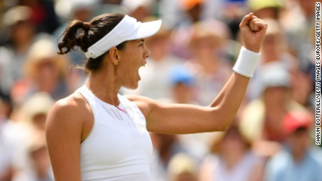 LONDON, ENGLAND - JULY 10:  Garbine Muguruza of Spain celebrates during the Ladies Singles fourth round match against Angelique Kerber of Germany  on day seven of the Wimbledon Lawn Tennis Championships at the All England Lawn Tennis and Croquet Club on July 10, 2017 in London, England.  (Photo by Shaun Botterill/Getty Images)