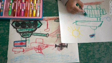 A child draws tanks and weapons during an art class in Pyongyang, North Korea. For North Korean children, the systematic indoctrination of anti-Americanism starts as early as kindergarten.