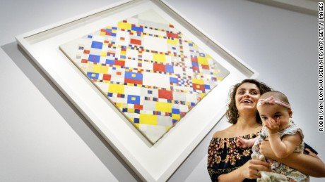 A mother and her child attend the first Baby Museum Tour in the Gemeentemuseum in The Hague on July 11, 2017. Ever wondered which artist is most preferred by babies? If it's up to the organisers of a tour for parents with small children in the Netherlands, the works of abstract artist Piet Mondrian win hands down. / AFP PHOTO / ANP / Robin van Lonkhuijsen / RESTRICTED TO EDITORIAL USE - MANDATORY MENTION OF THE ARTIST UPON PUBLICATION - TO ILLUSTRATE THE EVENT AS SPECIFIED IN THE CAPTION        (Photo credit should read ROBIN VAN LONKHUIJSEN/AFP/Getty Images)