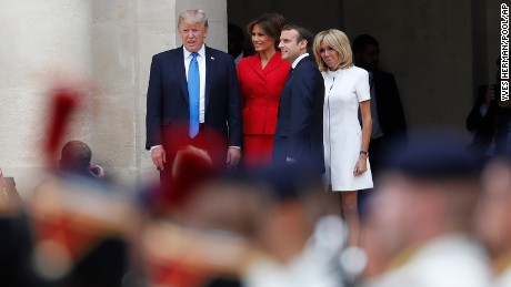 Macron and his wife Brigitte stand with Trump and First Lady Melania Trump during a welcoming ceremony at Les Invalides in Paris.