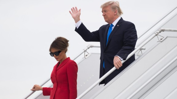 Trump waves as he disembarks from Air Force One with First Lady Melania upon arrival at Paris Orly airport.