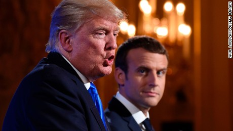US President Donald Trump (L) and French President Emmanuel Macron (R) hold a press conference following meetings at the Elysee Palace in Paris, on July 13, 2017, during the US president's 24-hour trip that coincides with France's national day and the 100th anniversary of US involvement in World War I. Donald Trump arrived in Paris for a presidential visit filled with Bastille Day pomp and which the White House hopes will offer respite from rolling scandal backing home.  / AFP PHOTO / SAUL LOEB        (Photo credit should read SAUL LOEB/AFP/Getty Images)