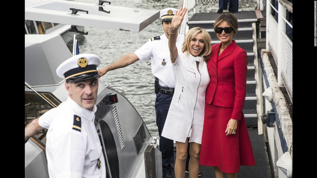 The first ladies leave a boat after a trip on the Seine River on July 13.