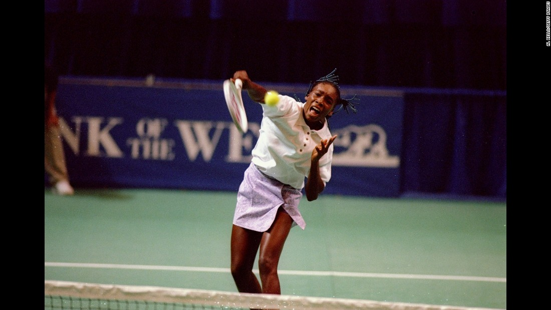 Venus hits an overhead during her first pro tournament in 1994.