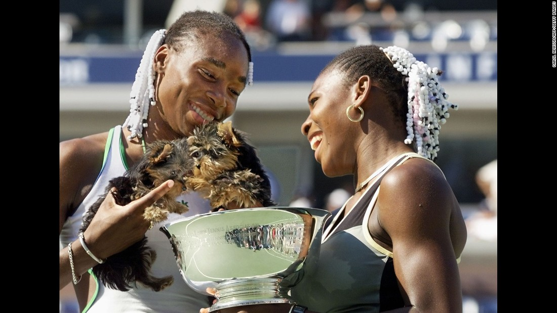 Venus and Serena hold their dogs after winning the US Open doubles title in September 1999.