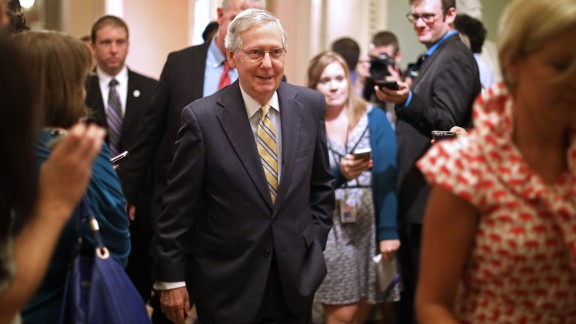 WASHINGTON, DC - JULY 13:  Senate Majority Leader Mitch McConnell (R-KY) smiles as he heads for the Senate Floor following a meeting where he shared a new version of a healthcare bill with fellow GOP senators at the U.S. Capitol July 13, 2017 in Washington, DC.  (Photo by Chip Somodevilla/Getty Images)