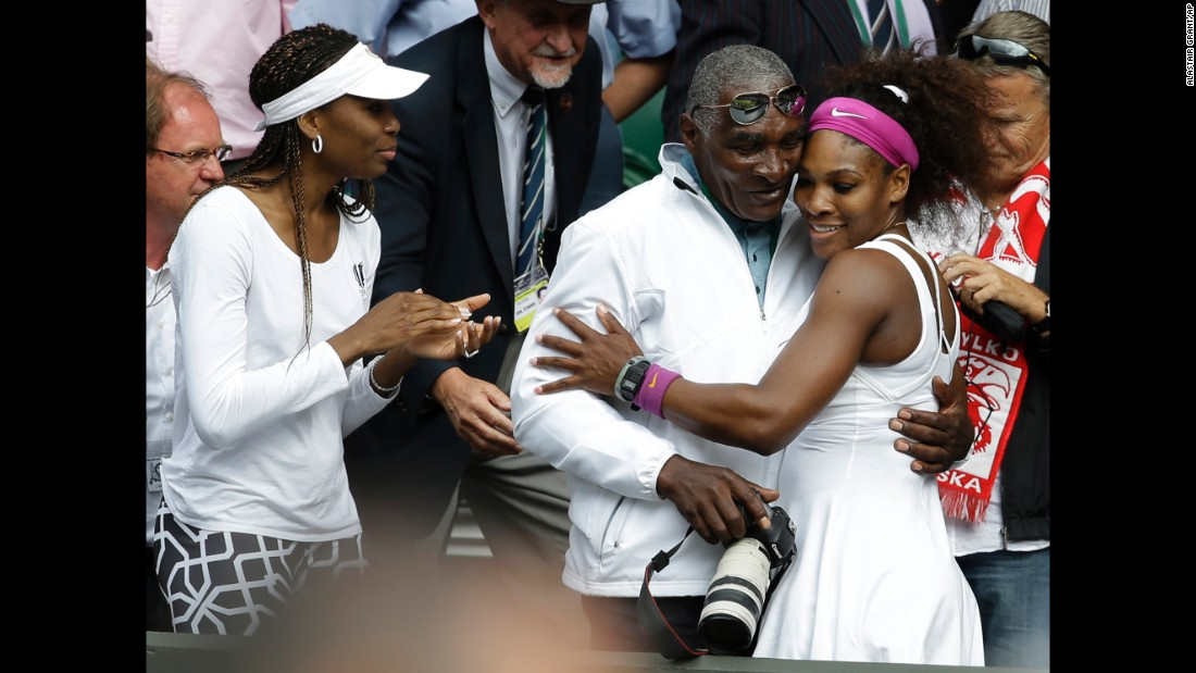 Venus watches Serena embrace their father after Serena won Wimbledon in 2012. A year earlier, Venus had been diagnosed with Sjogren's Syndrome, an autoimmune disorder that causes joint pain and can deplete energy levels. She took some time off but eventually returned.