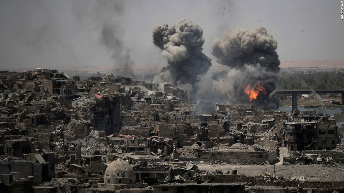 "Airstrikes target ISIS positions on the edge of the Old City of Mosul, Iraq, on Tuesday, July 11. <a href=""http://www.cnn.com/2017/07/09/middleeast/iraq-mosul-victory-claimed/index.html"" target=""_blank"">Iraq has declared victory in Mosul</a> after a grueling monthslong campaign to take the city back from ISIS."
