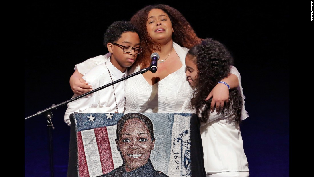 "The three children of New York City police officer Miosotis Familia participate in Familia's funeral on Tuesday, July 11. Familia <a href=""http://www.cnn.com/2017/07/11/us/new-york-police-officer-funeral/index.html"" target=""_blank"">was laid to rest </a>one week after being shot in the head while sitting in a marked command truck in the Bronx."